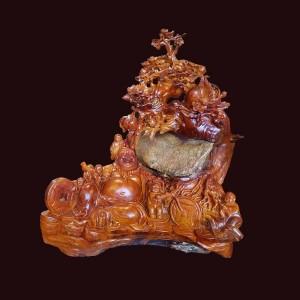 Tượng Di Lặc ngồi gốc đào ngũ phúc gỗ hương Gia Lai
